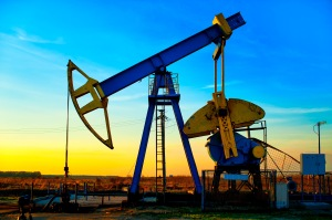 oil drilling at sunset